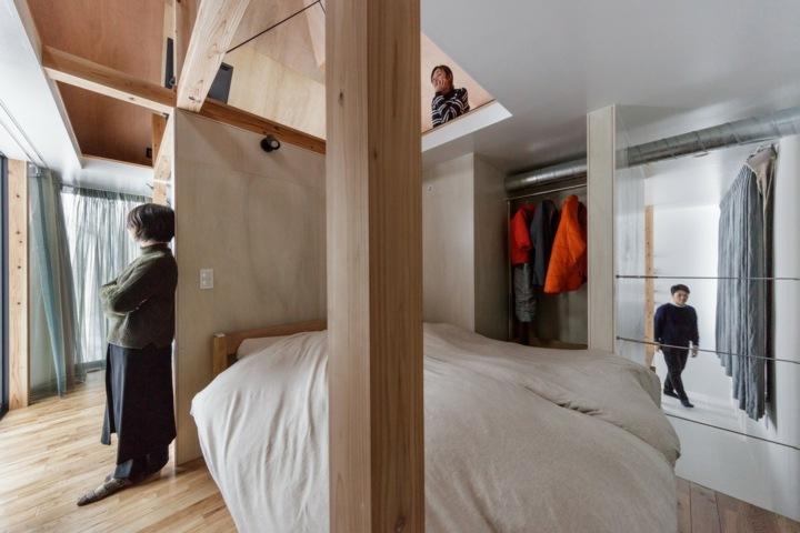 columnas-madera-verticales-dormitorio