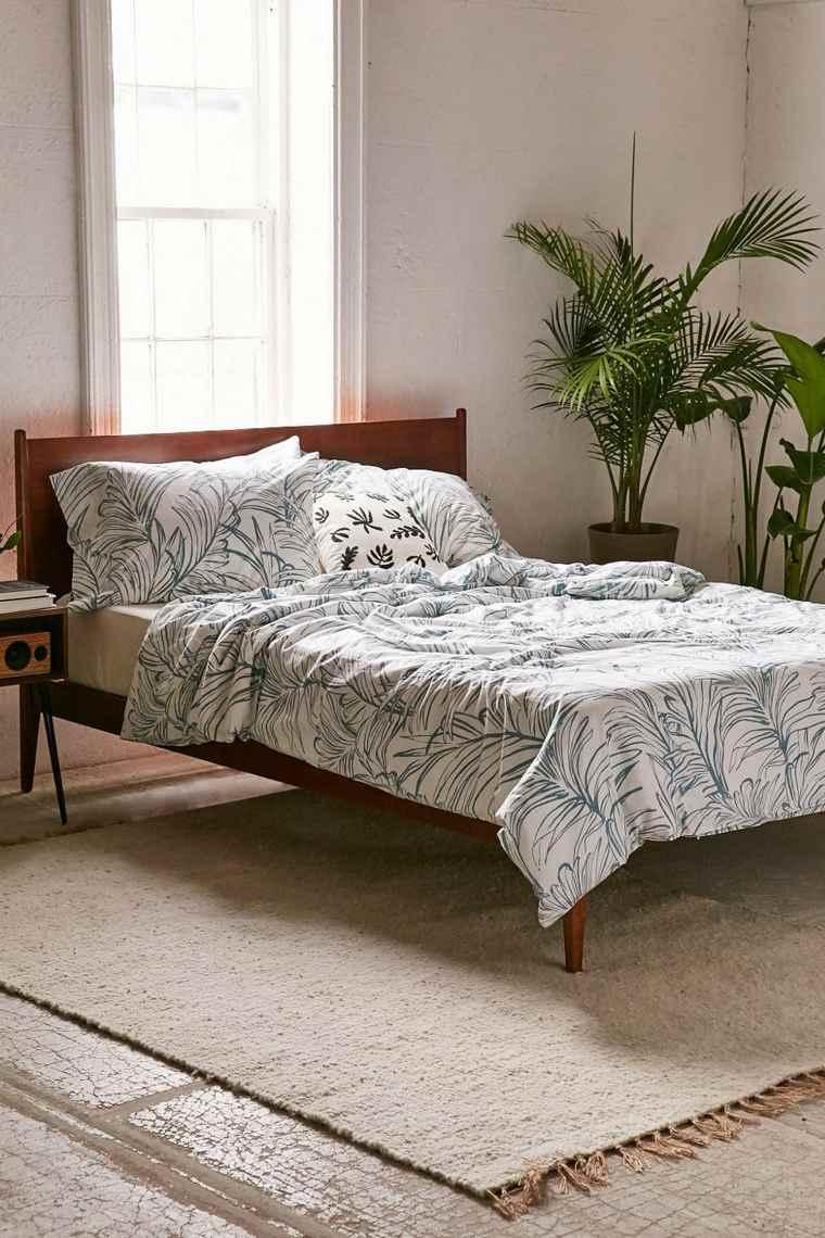 como-decorar-una-recamara-estilo-tropical-plantas-cama