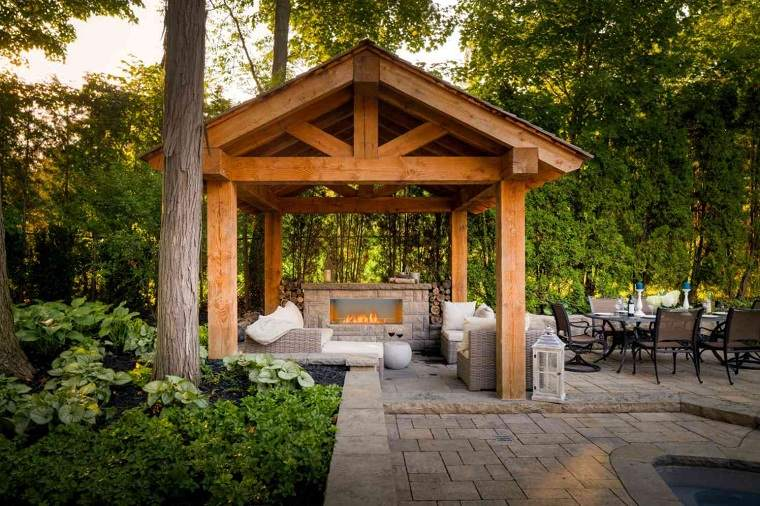 imagenes-de-chimeneas-piedra-jardin-moderno