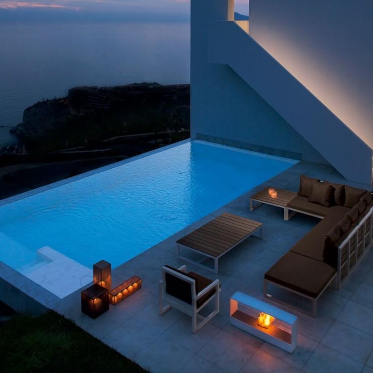diseños de jardines con chimeneas modernas