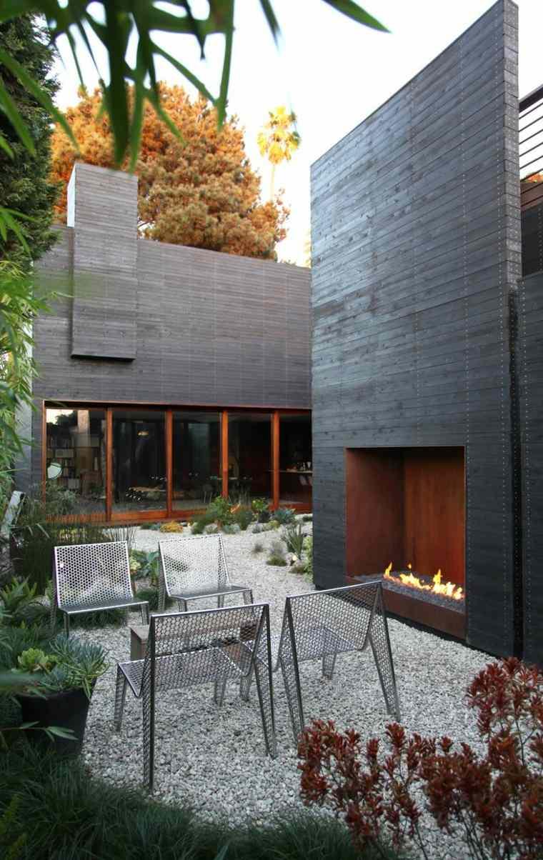 diseños de patios con chimeneas