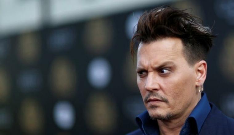 Johnny Depp mueca