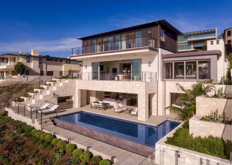 casa-grande-jardin-piscina-diseno-original