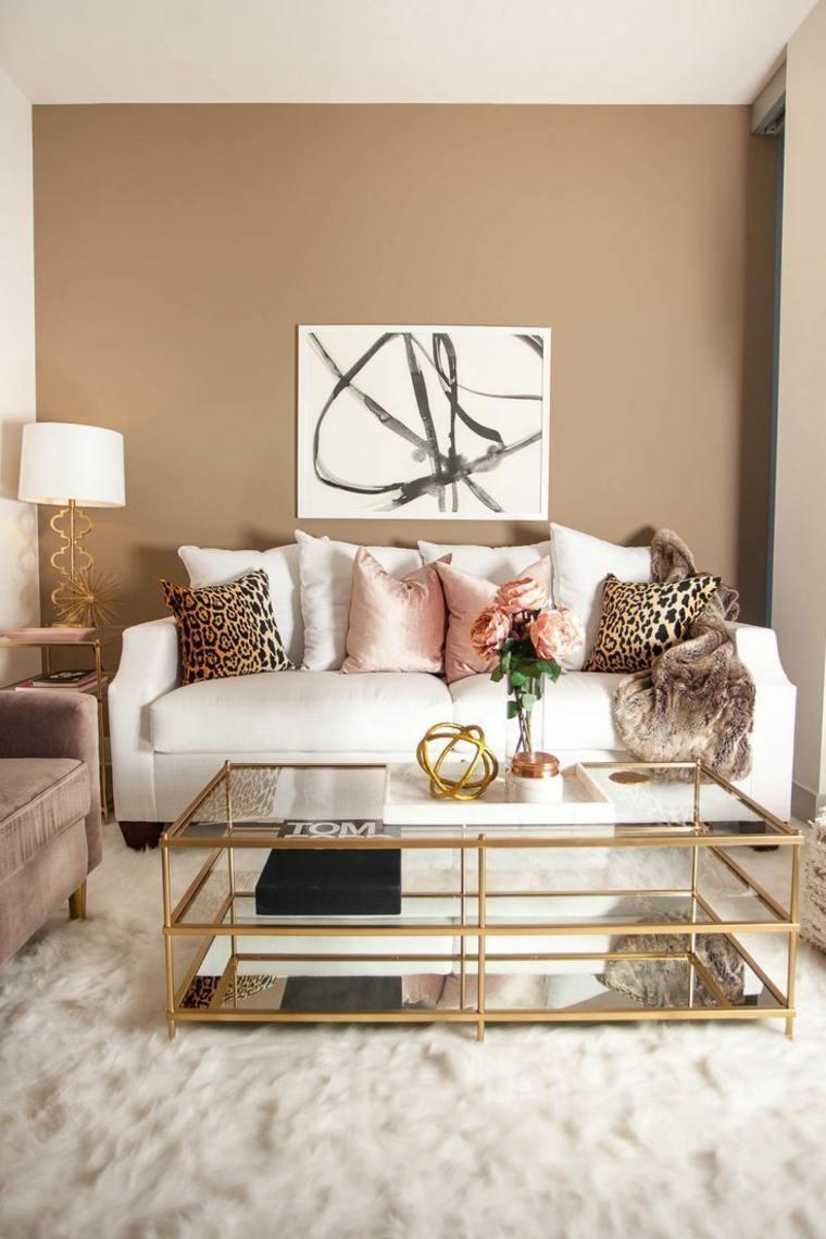 Colgar la decoración de la pared a 6-8 pulgadas sobre sus muebles