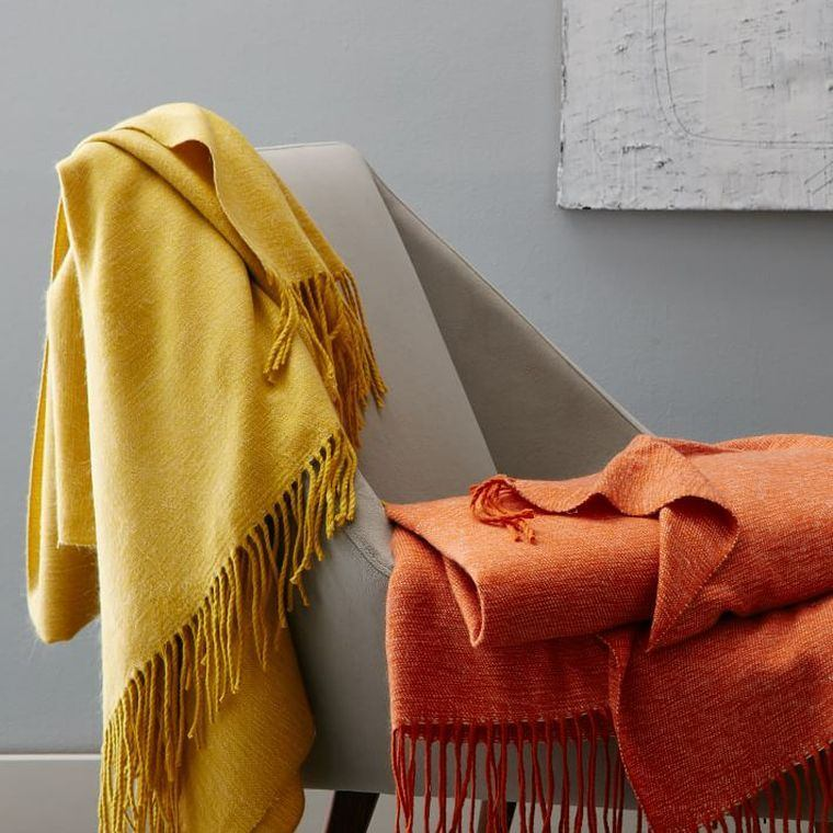 decoracion-interiores-acogedores-textiles-otono