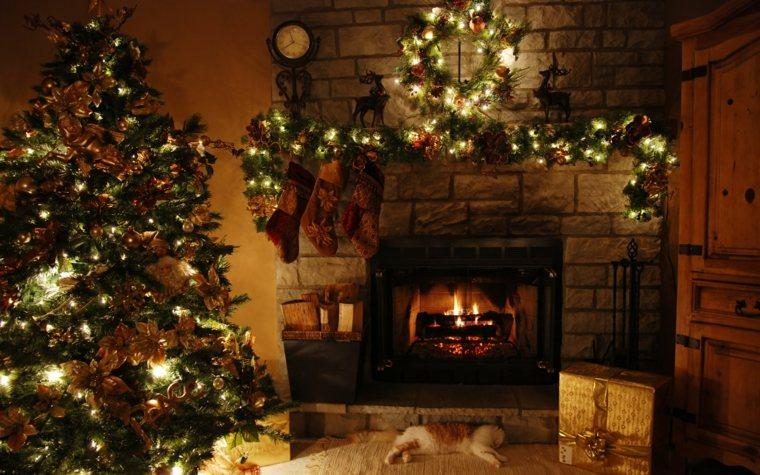 el arbol de navidad-decorando-chimenea