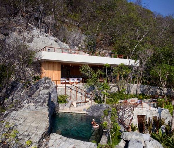 cabañas de madera diseño rocas