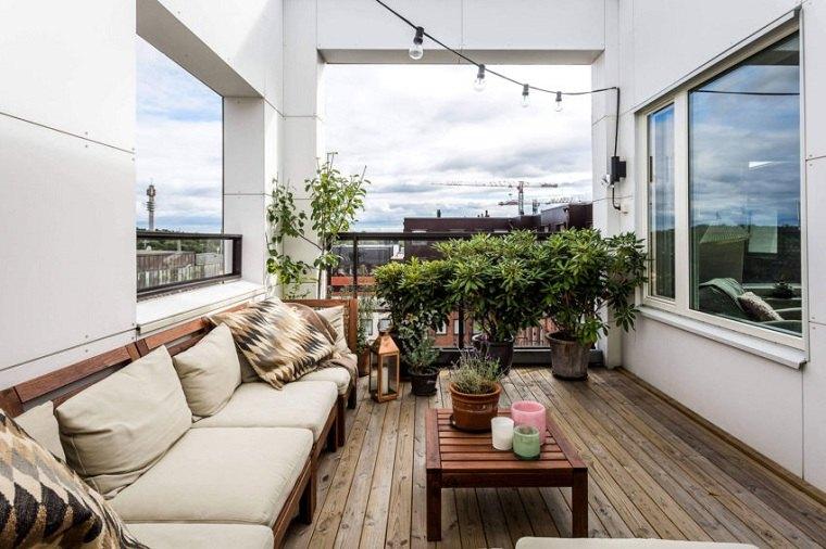 invierno-balcon-decorar-muebles-apartamento-estocolmo