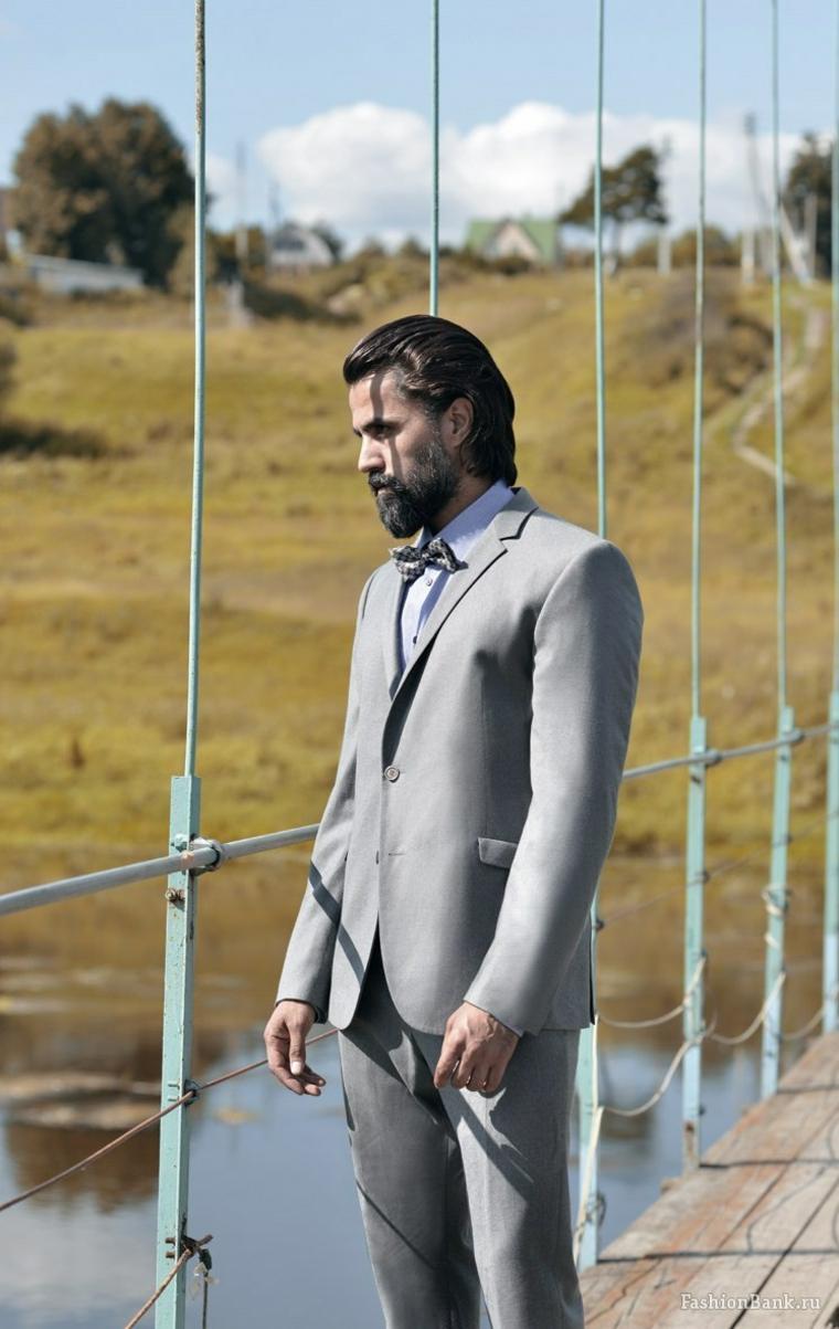 cabello-largo-baraba-hombre-traje-gris