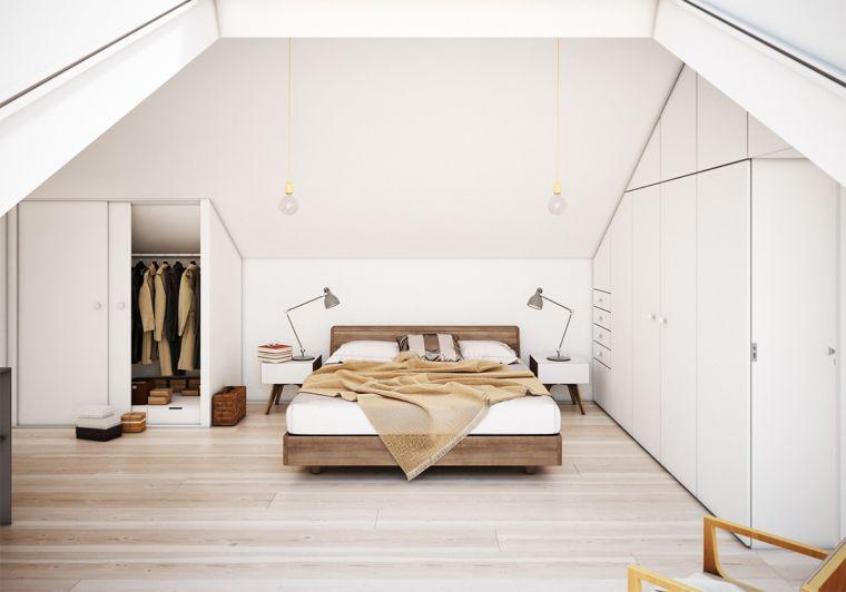 dormitorio luminoso con muebles blancos