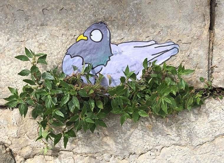 ejemplo de arte urbano nido de paloma