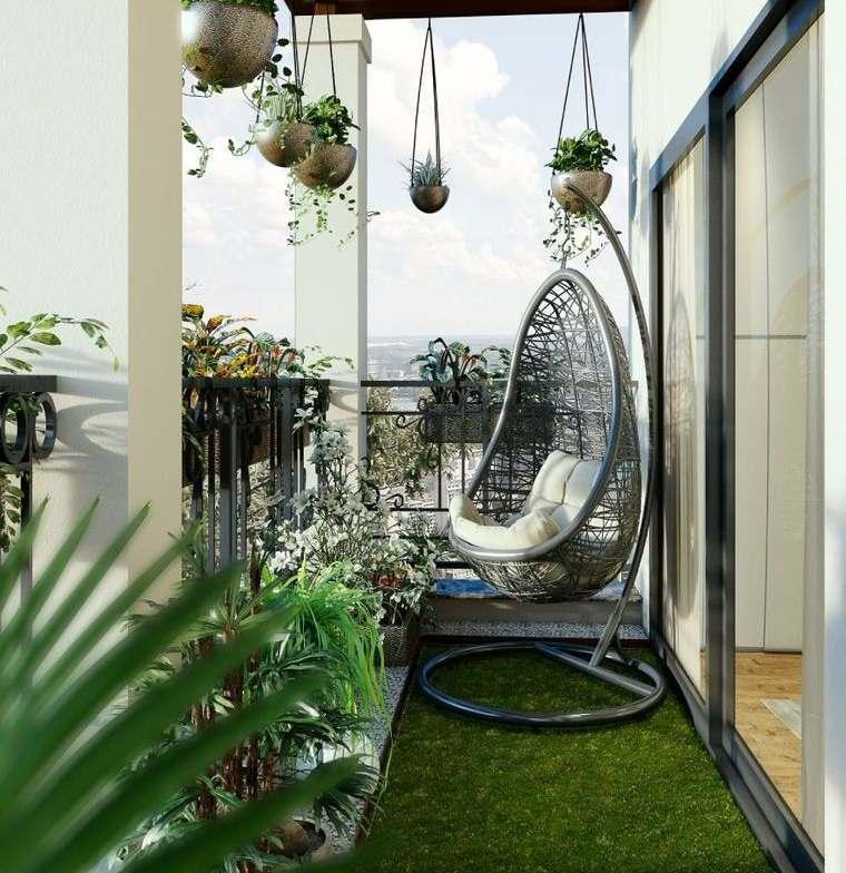 decorar balcón pequeño cesped piedra