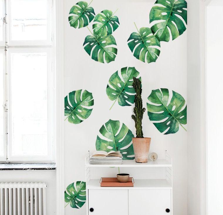 Decoración de interiores con hermosas hojas verdes