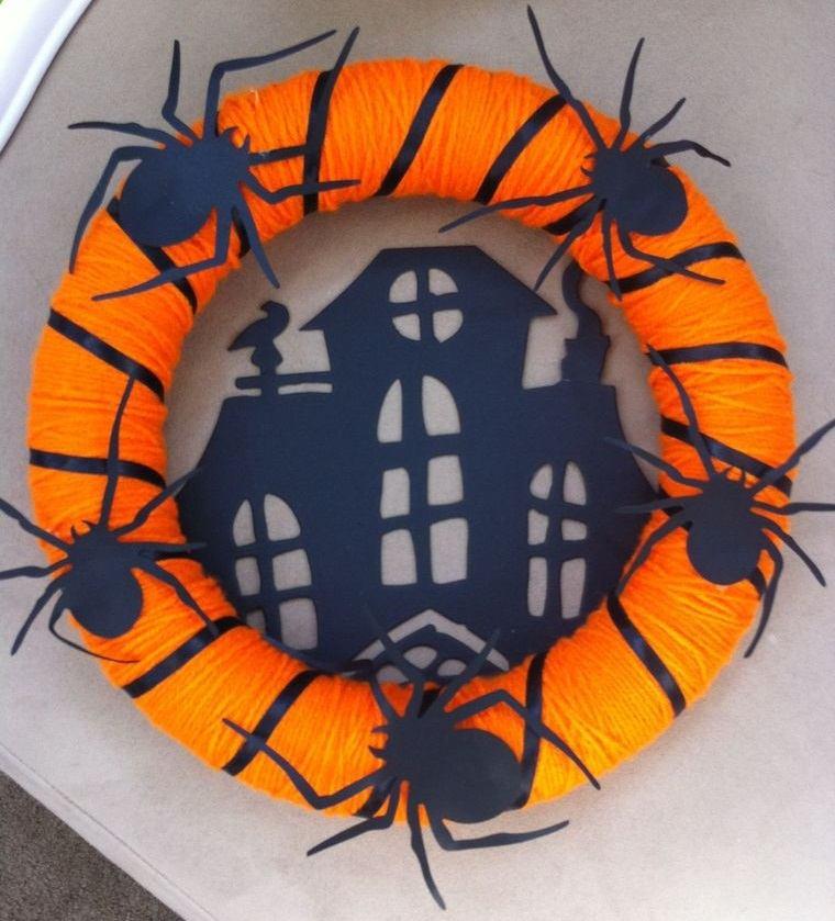 corona hilo naranja negro arañas