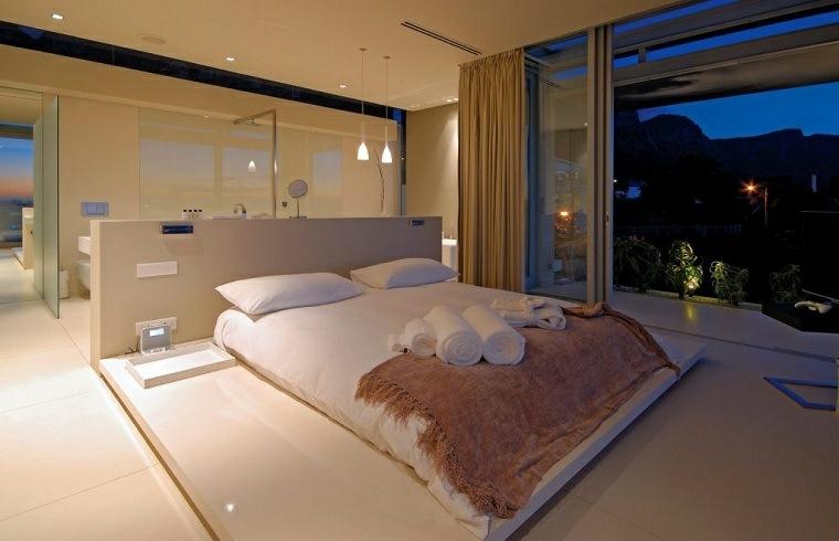dormitorio con baño detras-cama-ideas