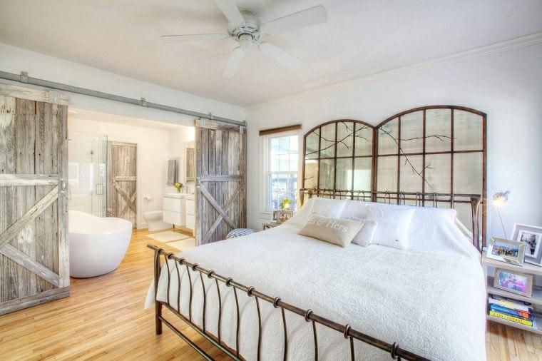 dormitorio-con-ducha-puertas-granero.