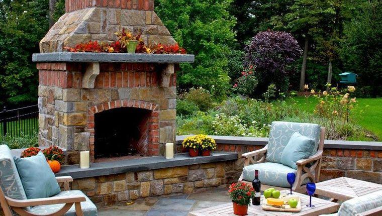 decoración rústica patio chimenea