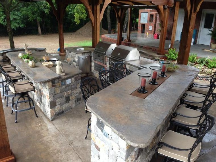 la cocina exterior con piedra
