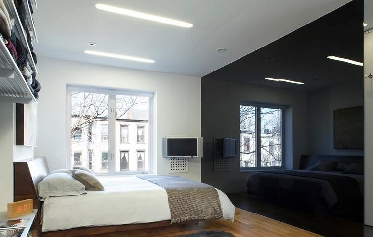 dormitorio-pared-cristal-negro