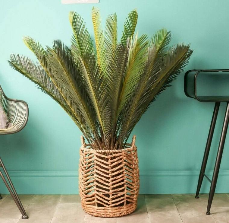 flores artificiales palmas