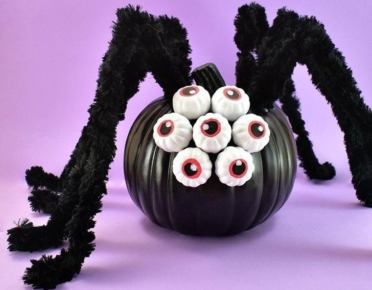 decoración de halloween araña gigante de calabaza